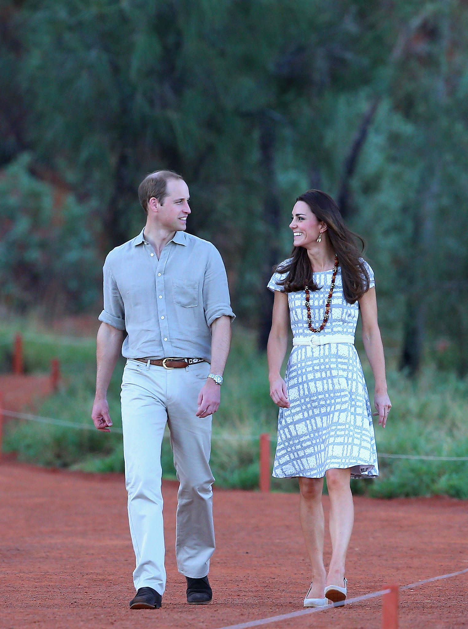 Prince William and Kate talked while walking around the base of Uluru in Ayers Rock on their 2014 trip to Australia.
