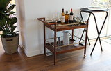 We couldn't believe that this gorgeous midcentury-inspired bar cart is actually from West Elm!