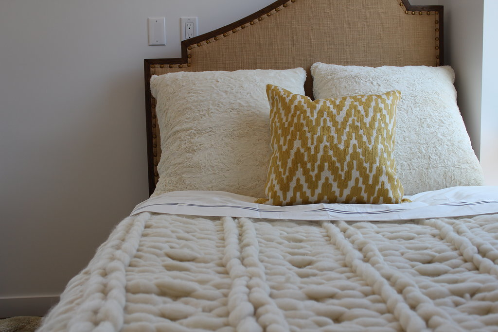 In the guest bedroom, an incredibly soft, oversize knit throw by Jessie Black steals the show.