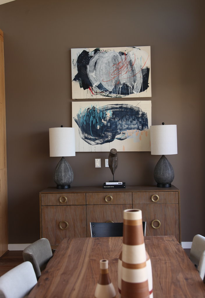 Abstract paintings by Bay Area-based artist Heather Day perk up the coffee-colored wall in the dining area. Photo: Chi Chau