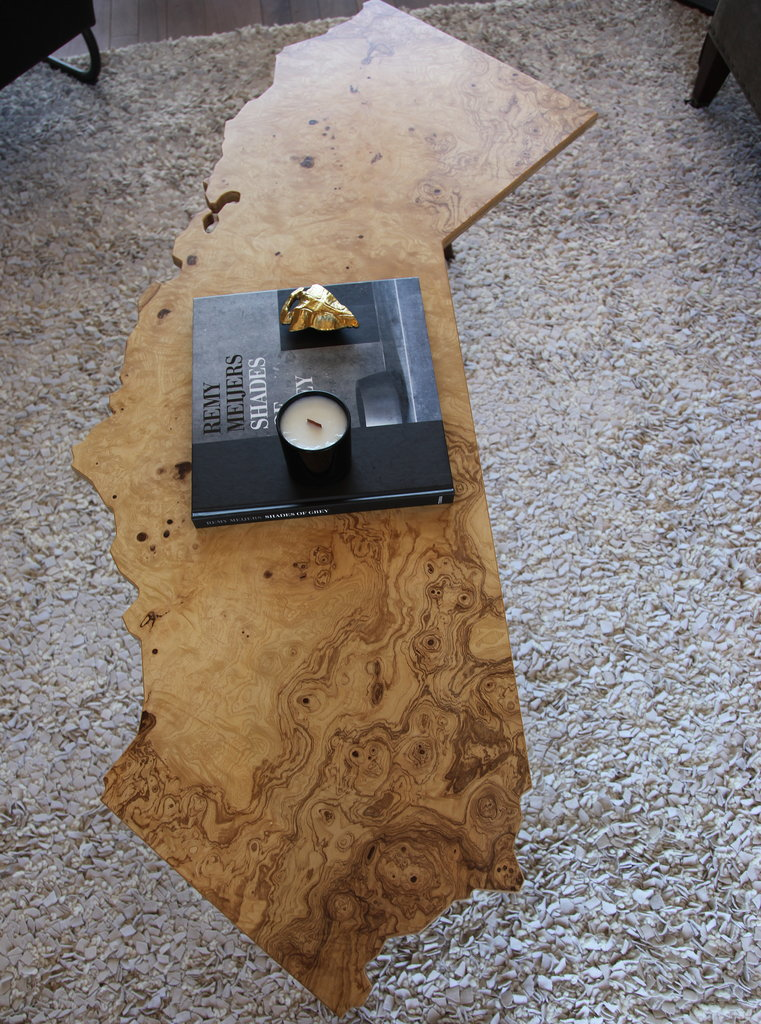 But our favorite piece in the room might have to be this California-shaped coffee table by Blue Collar Built.  Photo: Chi Chau