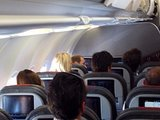 William sat in coach on an American Airlines flight on Sunday.