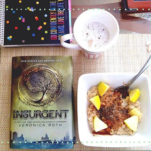 """Who says Mondays are tough?"" writes clodi_fit along with this pic of breakfast and Insurgent."
