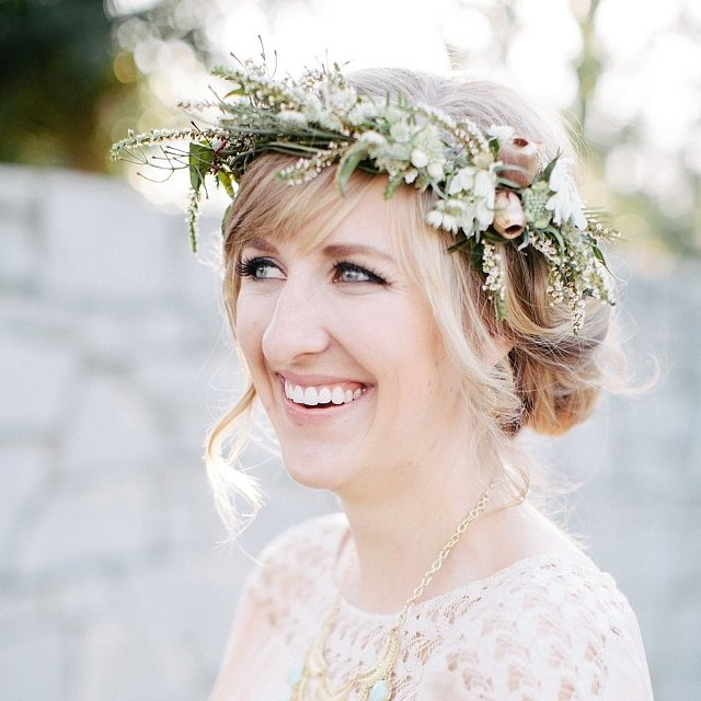 When it's time to order flowers for your wedding, don't forget to snag petals for your hair. Whether you stick a few buds in your updo or crown yourself with a floral wreath, the looks featured here by POPSUGAR Beauty are ideal for a botanical-themed ceremony or Summer garden party. Photo by Jen Dillender Photography via Style Me Pretty