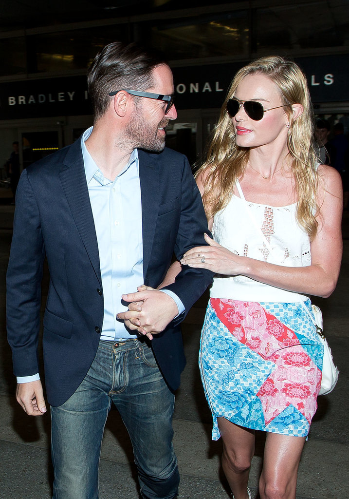Kate Bosworth and her husband, Michael Polish, kept close at LAX on Tuesday.