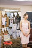 Katherine Fotinos, assistant editor at Glam, stood by her display at the event. Photo by Ettevy Photography
