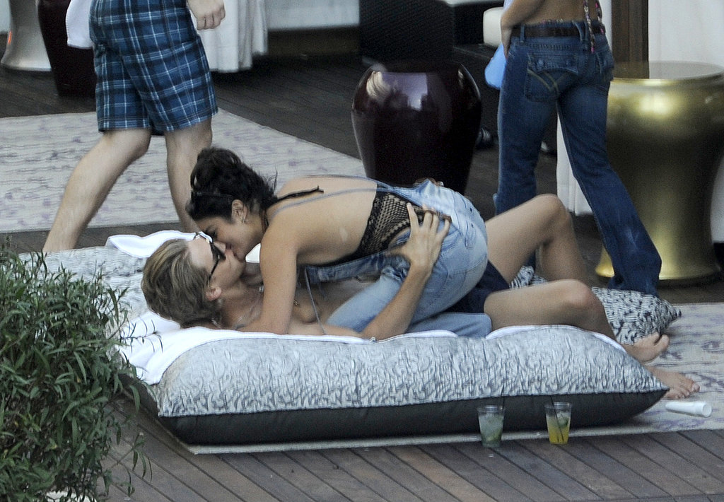 Vanessa Hudgens straddled boyfriend Austin Butler as they hung out by the pool in Miami in December 2011.