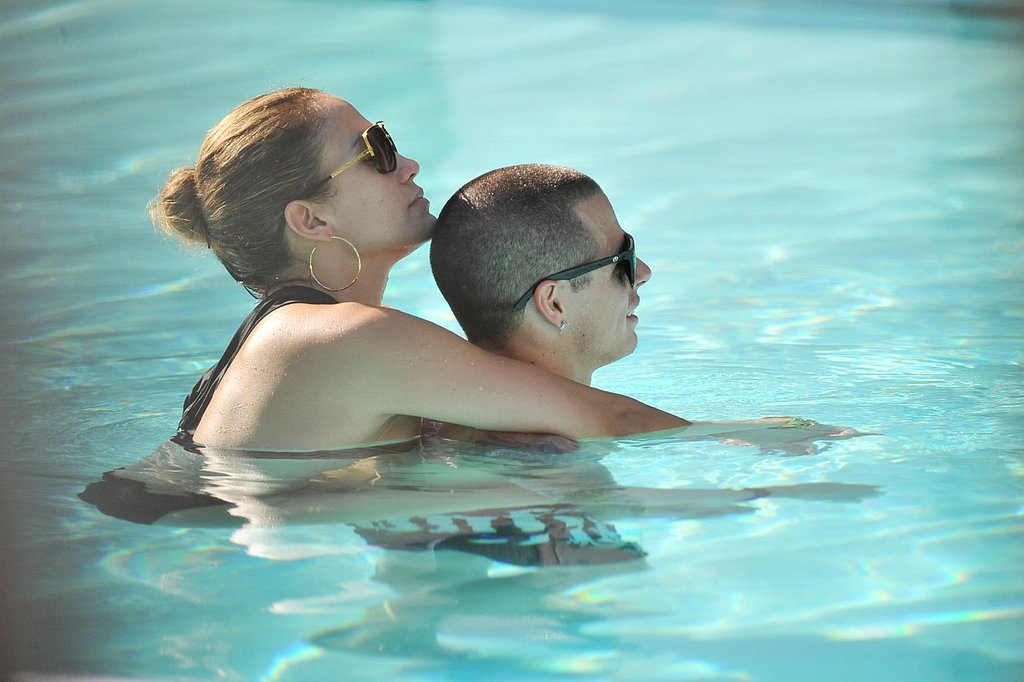 Jennifer Lopez held on to boyfriend Casper Smart as they relaxed in the pool in Miami in September 2012.