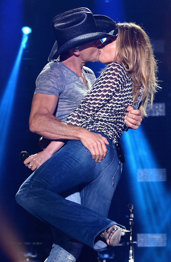 Tim McGraw and Faith Hill shared a steamy kiss onstage at the CMA Festival in Nashville on Thursday.