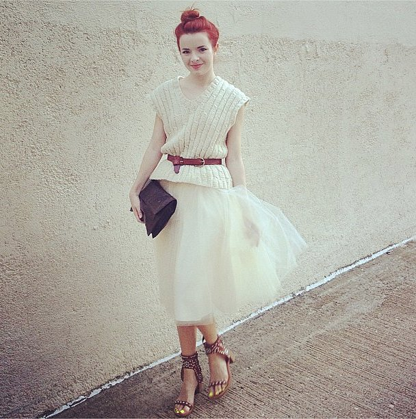Take a page out of Carrie Bradshaw's playbook and dress down a whimsical skirt with a knit top and practical (albeit gorgeous!) heels. Source: Instagram user seaofshoes