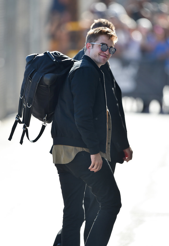 Robert Pattinson smiled while out in LA on Thursday ahead of his big premiere for The Rover that same night.
