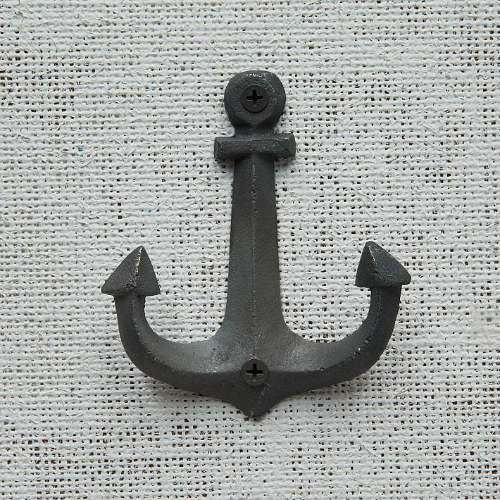 Add a nautical twist to your front entry by hanging this anchor hook ($12) for hats.