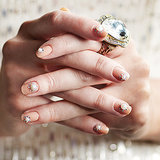 A french manicure may be the go-to nail design for weddings, but challenge that old-fashioned idea with a fresh new take on classic and pretty nail art for the modern bride. The pearl and rhinestone nail design, brought to you by POPSUGAR Beauty is from Stephanie Lavery, editor in chief of Nail It! Magazine. See how to get the look. Source: Nail It! Magazine