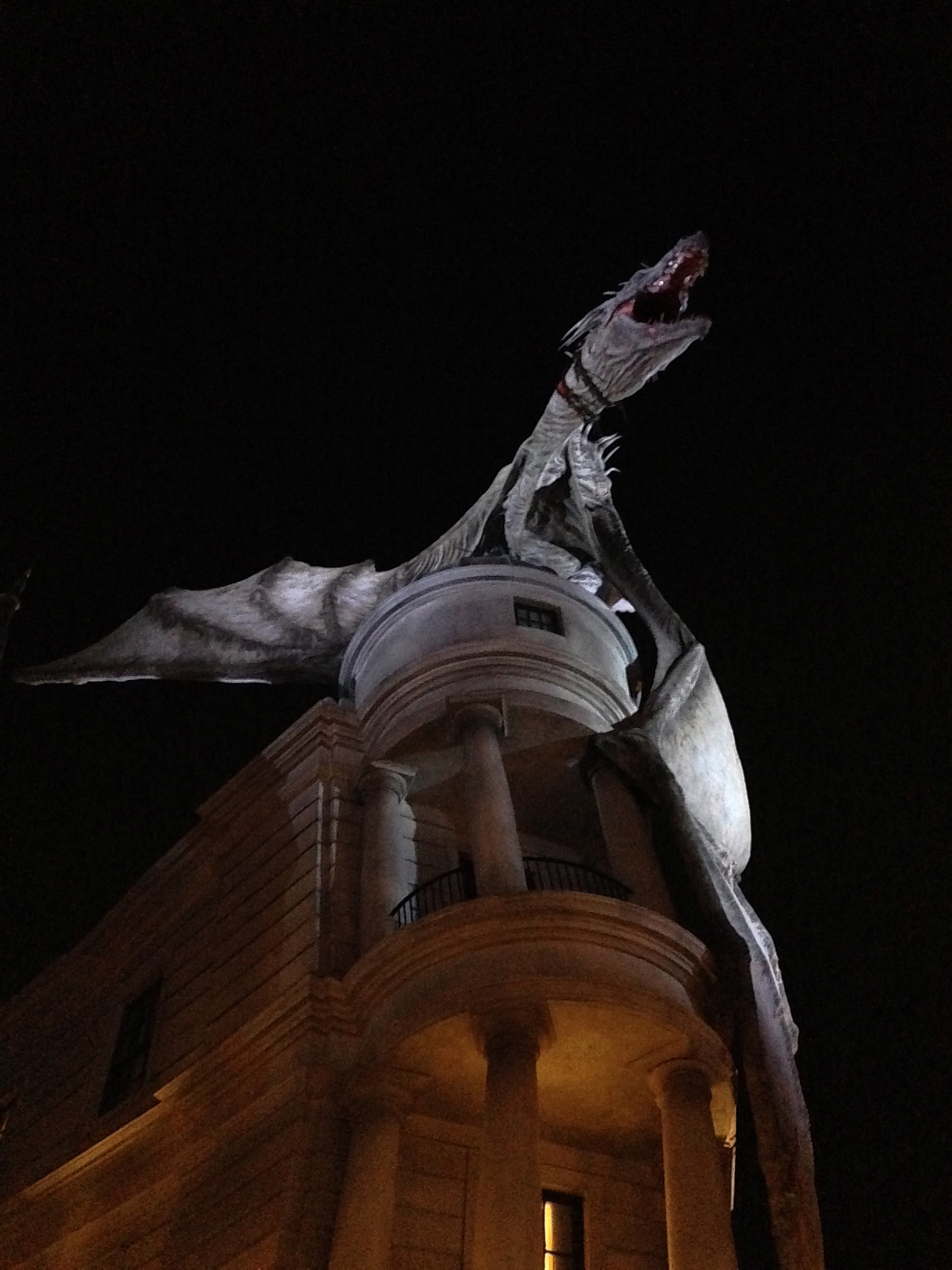 An extremely lifelike Ukrainian Ironbelly dragon sits atop Gringotts Bank and breathes real, hot fire every few minutes.