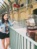 Hedwig and I shared a moment at Platform 9 3/4 in King's Cross Station.