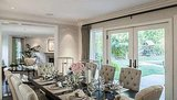 The dining room is large enough to seat 10 and has glass doors leading  outside. Source: Redfin