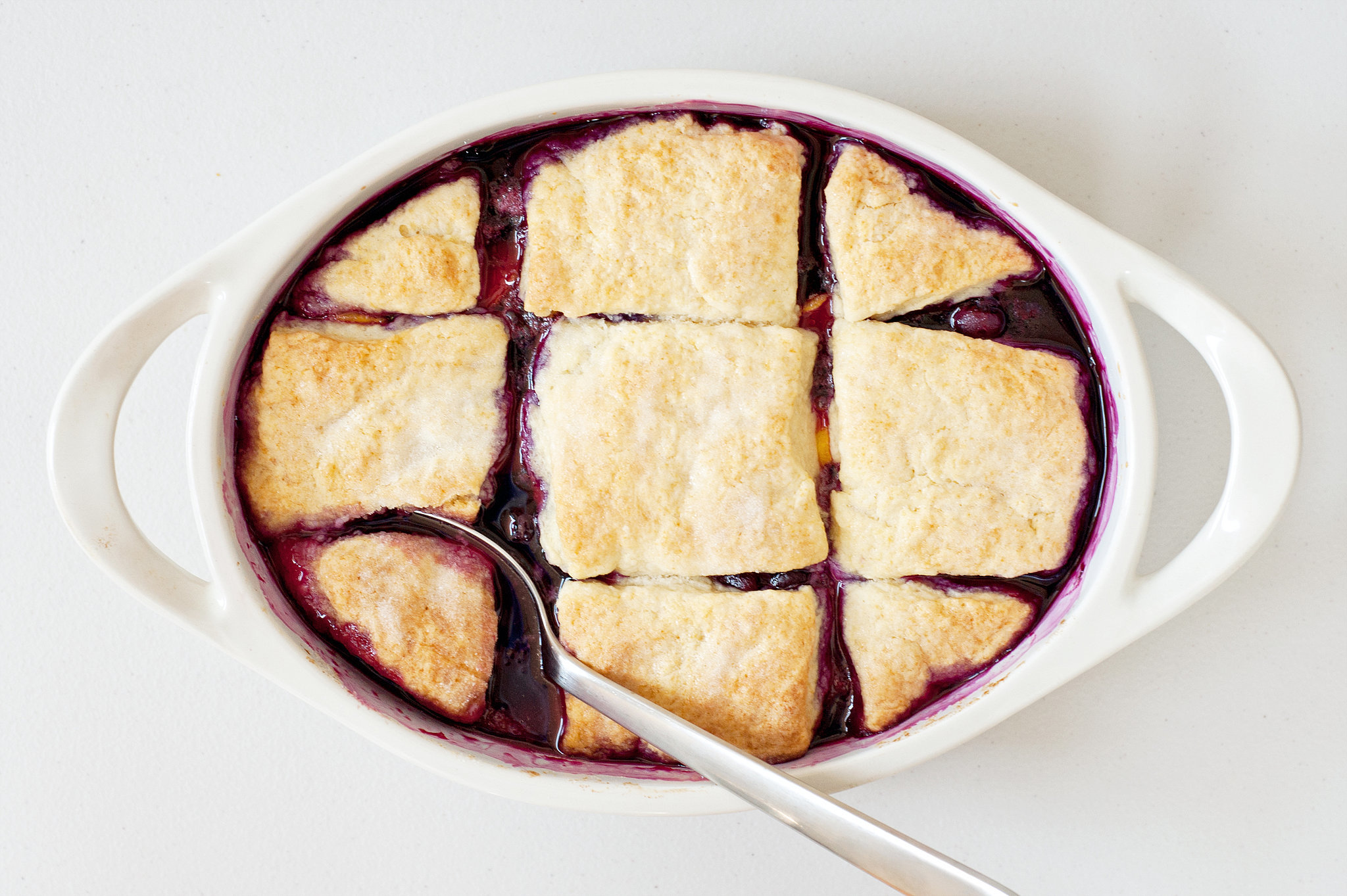 of blueberry and peach season with this simple biscuit-paved cobbler ...