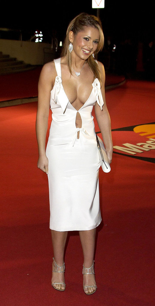 At the 2005 Brit Awards, it was all about the cleavage for Cheryl Cole in this frilled midi dress.