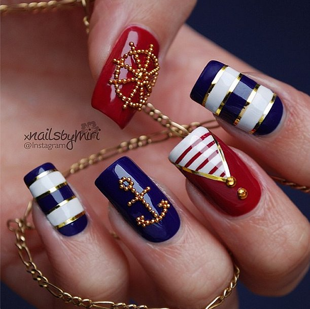 We're obsessed with the meticulous anchor and wheel arrangements of those little gold beads. Source: Instagram user xnailsbymiri