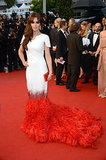 Cheryl Cole stunned in a white Stéphane Rolland couture dress with a red feathered train at the Cannes Film Festival in 2012.