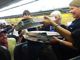 The Greatest Airline Pilot Ever Orders Pizza for Stranded Passengers