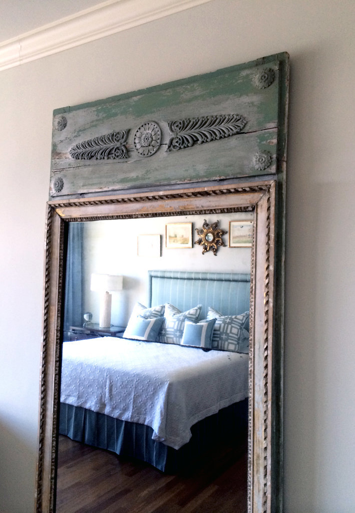 The secret to her standout master bedroom? A mirror from a Parisian flea market with a wooden headboard of its own. Très cool!