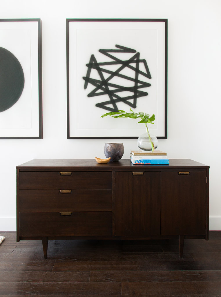 Modern art and a sleek console table make for the perfect pair.   Photo by Tessa Neustadt via Homepolish