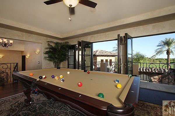 A pool table is a fun way to enjoy the air-conditioned indoors.  Source: Realtor.com