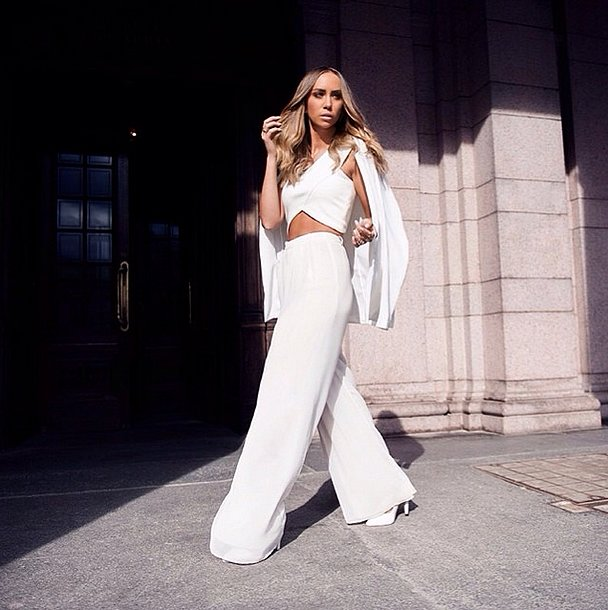 Sleek, milk-white trousers scream Summer, and a crisscross crop top is the ultimate waist fla