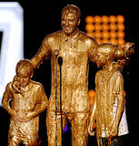 David Beckham and his kids got slimed with gold at the Nickelodeon Kids' Choice Sports Awards on Thursday in LA.