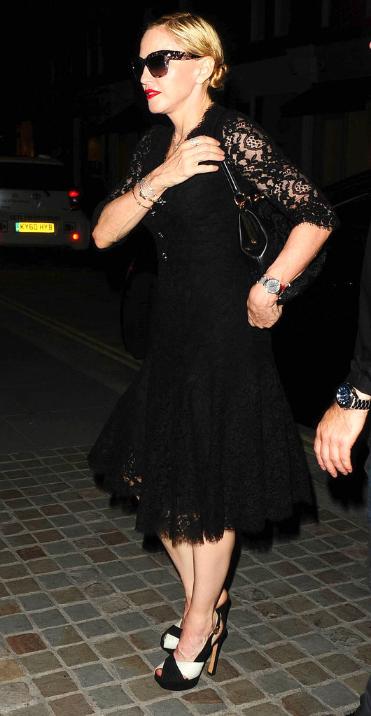 Madonna wore her sunglasses while out in London on Friday night.