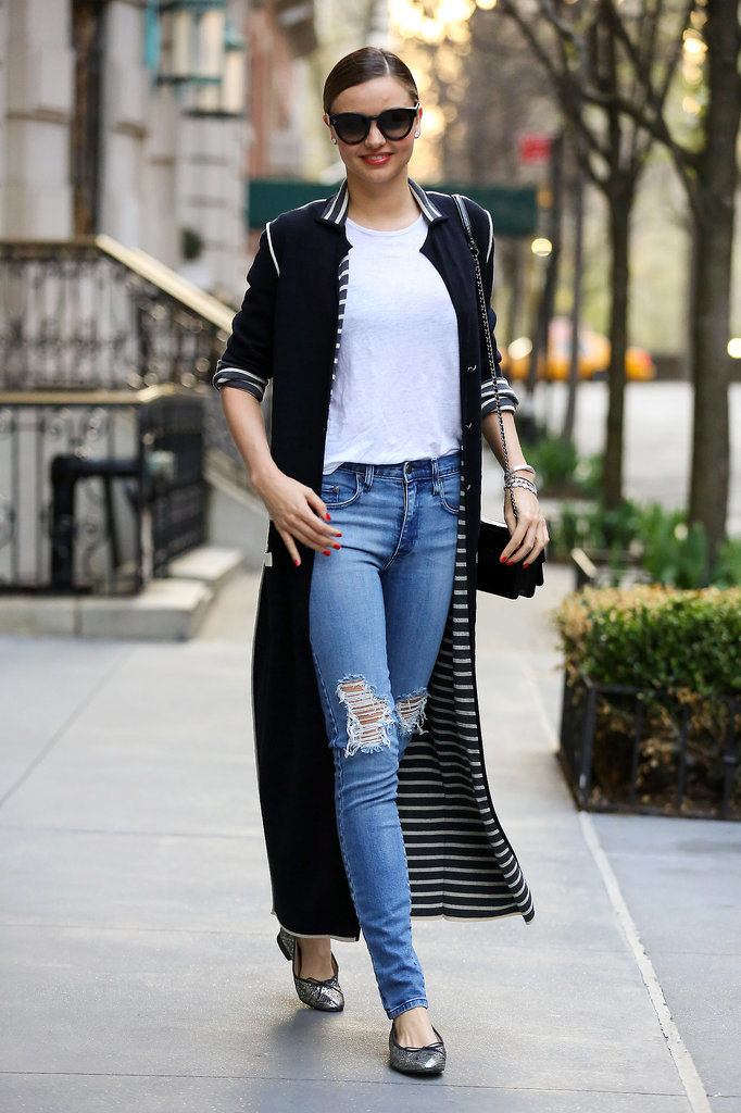 We love the interior detail of Miranda's full-length cardigan. With a mini Chanel box-clutch, ballet flats, and distressed jeans, this outfit makes for casual weekend wear at its finest.