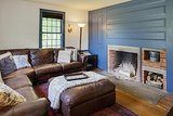 The blue accent wall offers an updated look to one of the home's seven fireplaces.  Source: Landvest