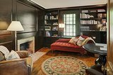 The wood-paneled library is likely one of the best rooms in the house.   Source: Landvest