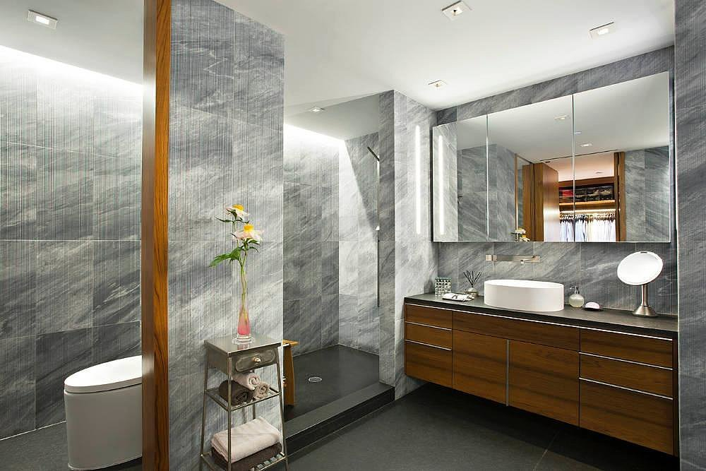 If she isn't in the mood for a long soak, there's a spacious shower. Source: Town Real Estate