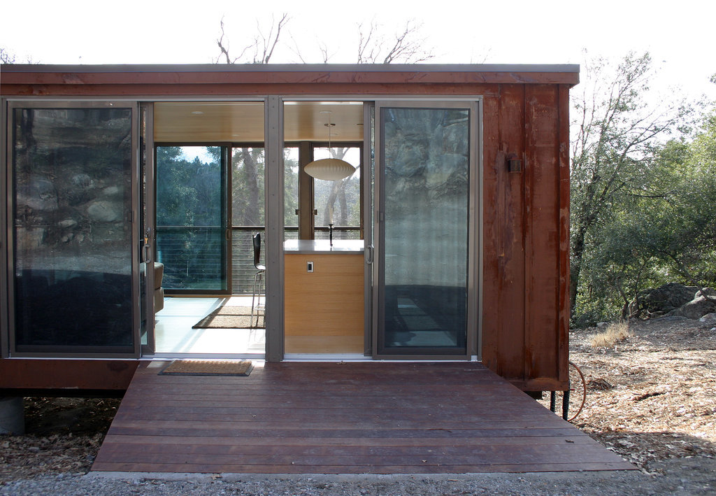 The Palomar Mountain weeHouse, located in San Diego, CA, is a gorgeous example of tiny housing done right. The small space uses windows to create a feeling of openness, and features a wooden deck as an outdoor extension of the home.