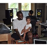 """Kim shared this sweet photo of Kanye and North in August 2014, with the caption """"#bringyourdaughtertoworkday."""""""