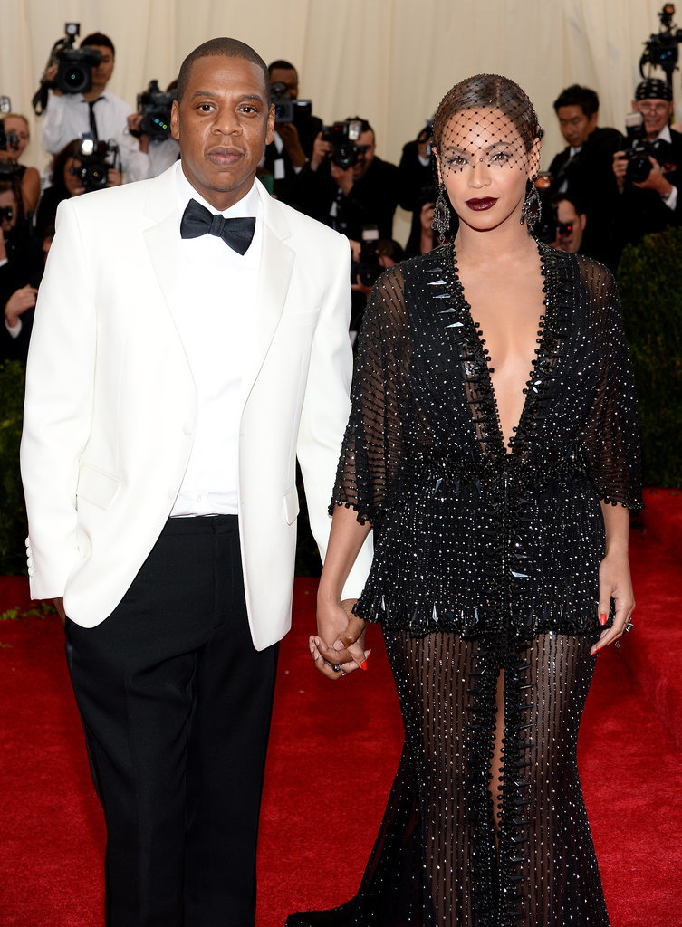 """Source: Getty / Dimitrios Kambouris  May 5: Beyoncé and Jay Z showed up hand in hand for the Met Gala in NYC. They shared a sweet moment on the red carpet when Beyoncé's ring fell off her hand and Jay Z adorably placed in back on her finger in a mock proposal. May 6: While leaving a Met Gala afterparty in the early hours, Jay Z, Beyoncé, and her sister, Solange, were photographed looking less than thrilled while heading back to their cars. Beyoncé and Solange left together while Jay Z took a different vehicle. May 7: Beyoncé shared a photo on Instagram of a prayer asking for """"discernment and strength to separate myself from anyone who is not a good influence."""" May 12: TMZ released footage of Jay Z being attacked by Solange in an elevator while leaving the party. The video shows Solange punching and kicking the rapper before being restrained by a bodyguard — Beyoncé appears to stand by without reaction before attempting to come between her husband and sister, ultimately letting Solange continue to scream and kick Jay Z before the footage ends.   Source: TMZ"""