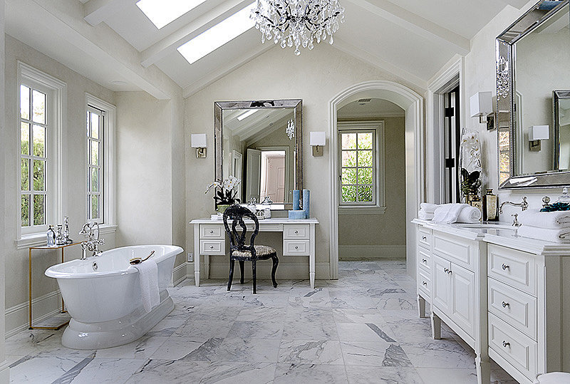 Marble floors, an elegant vanity, and plenty of natural light fill one of the estate's many bathrooms.  Source: Zillow