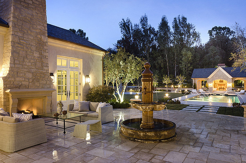Fountains, fireplaces, and comfortable seating will help the family enjoy California's wonderful weather.  Source: Zillow
