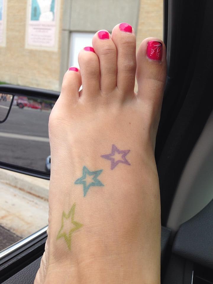 """I didn't even get my first tattoo until after I had my three kids. I have three stars on my feet for my kids."" — Sheena Barker Grant"