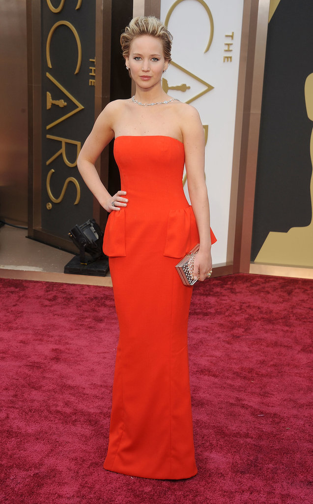 """While we love how polished Jennifer looked in this peplum Dior gown at the 2014 Oscars, our favorite element was her diamond Neil Lane """"backlace."""""""