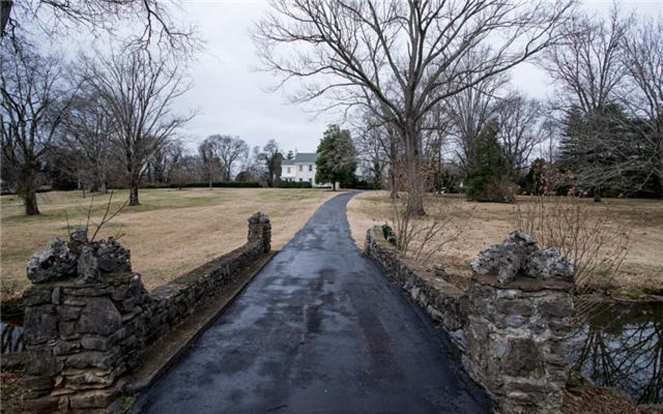 The grand driveway that leads to the house will look gorgeous once the grounds are in better shape. Source: Zillow