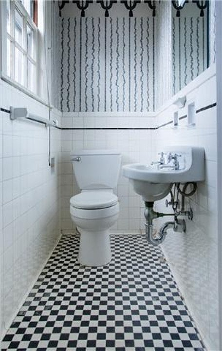 This bathroom is small, but the vintage touches are perfect for a historic home renova