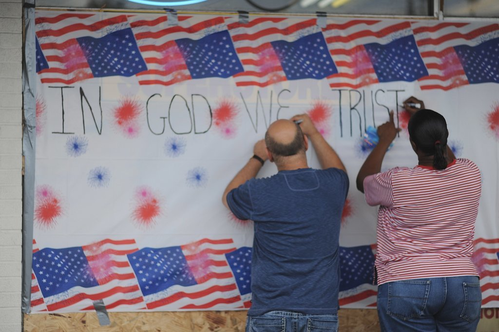 People in St. Louis signed a wall in honor of Michael Brown during a peaceful protest.