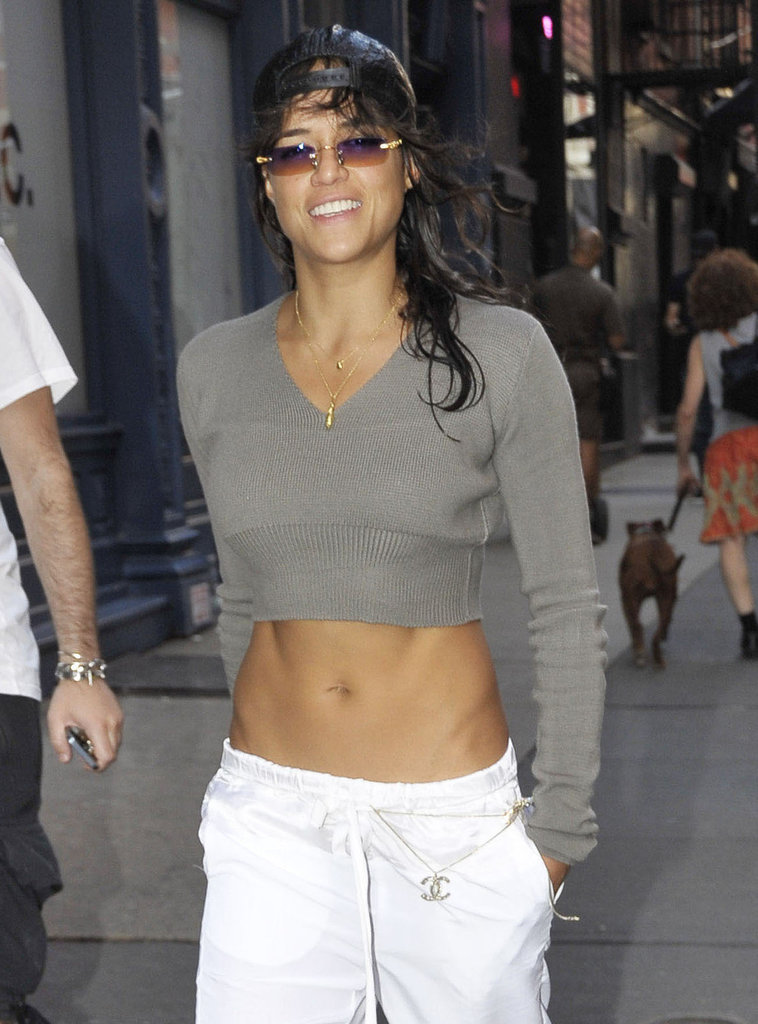 Michelle Rodriguez bared her taut midriff in NYC on Wednesday, the same day we learned her relationship with Zac Efron is reportedly over.