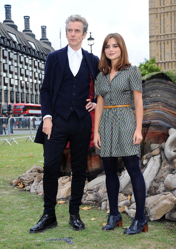 The day before the new series launched, Jenna attended a photocall in London wearing a printed shirtdress, black tights, and ankle boots.