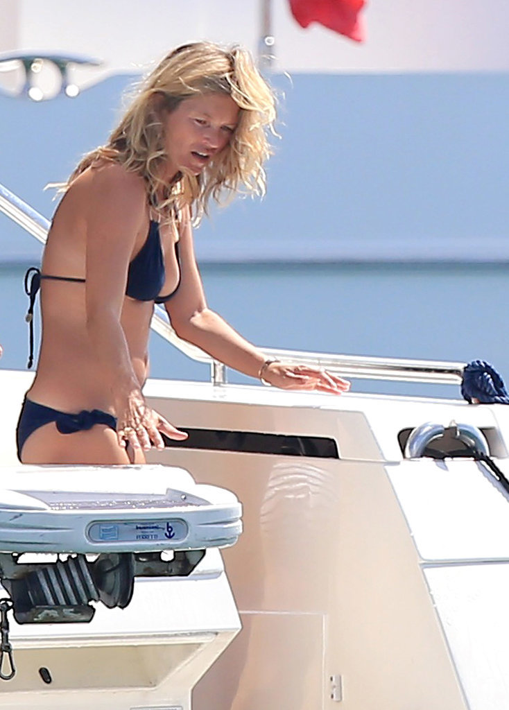 Kate Moss slipped into a black bikini while vacationing in Spain on Thursday.