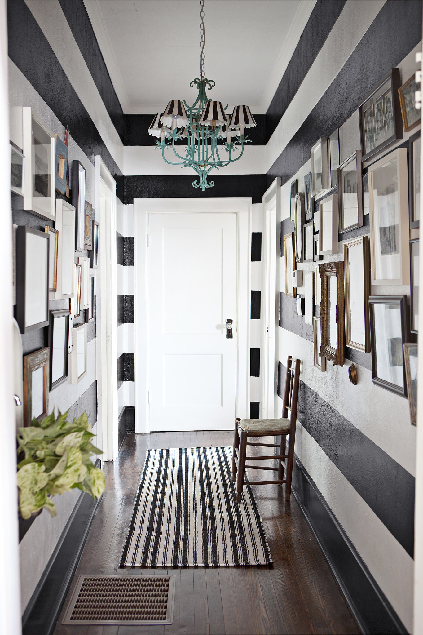 How to decorate a narrow hallway popsugar home for Wall design in hall