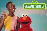 "Lupita Nyong'o Visited Elmo On ""Sesame Street"" To Talk About Loving Your Skin"